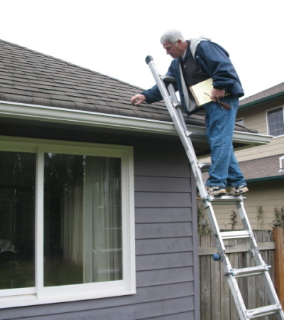 Dan inspecting a home's roof.